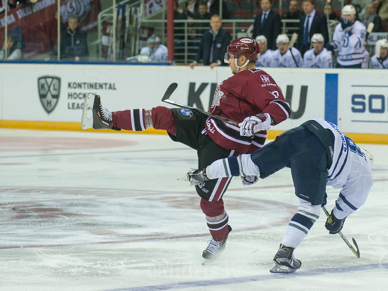 Kaspars Saulietis (17) of Dinamo Riga collide with player od Dynamo Moscow in the KHL regular championship game between Dinamo Riga and Dynamo Moscow, played on October 3, 2016 in Arena Riga