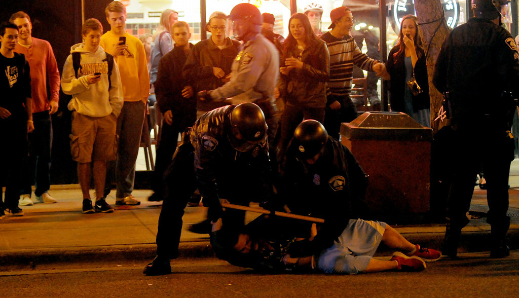 . A U of M fan is arrested by Minneapolis police officers on Saturday night after fans in Dinkytown got out of hand after the loss to Union. (Pioneer Press: Sherri LaRose-Chiglo)