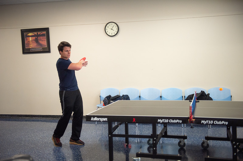 Student Ben Hugh takes time to improve on his ping-pong skills at the Dugan Wellness Center.
