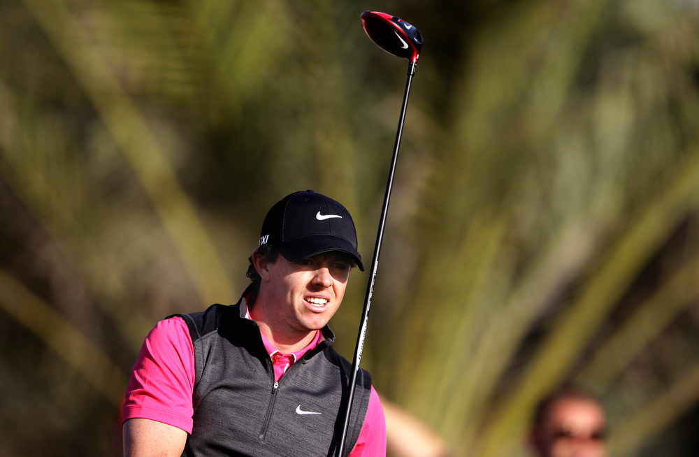 Description of . Rory McIlroy from Northern Ireland follows his ball on the 14th hole during the first round of Abu Dhabi Golf Championship in Abu Dhabi, United Arab Emirates, Thursday, Jan. 17, 2013. (AP Photo/Kamran Jebreili)
