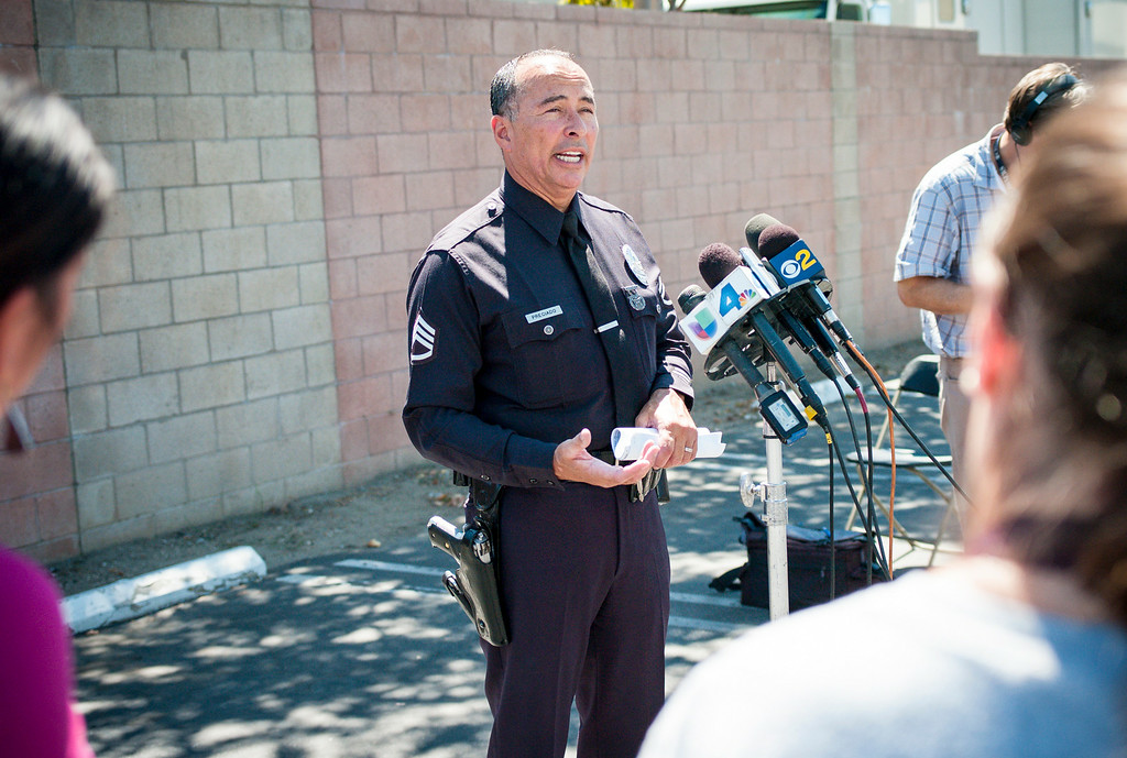 . Frank Preciado of the LAPD describes shootings which took place early Sunday morning in the San Fernando Valley which left 3 people dead.  Police are looking for a tan SUV with two male hispanic suspects.  ( Photo by David Crane/Los Angeles Daily News )
