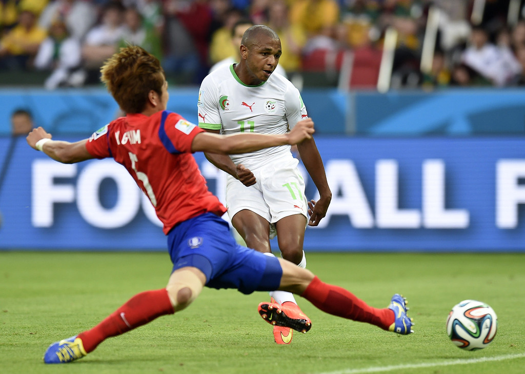 . Algeria\'s midfielder Yacine Brahimi (R) kicks the ball to score his team\'s fourth goal during the Group H football match between South Korea and Algeria at the Beira-Rio Stadium in Porto Alegre during the 2014 FIFA World Cup on June 22, 2014.   PHILIPPE DESMAZES/AFP/Getty Images