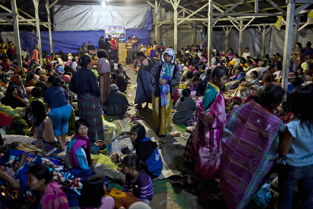 . Villagers are seen in a temporary evacuation shelter in Berastagi village on November 25, 2013 in Karo district, North Sumatra, Indonesia. (Photo by Ulet Ifansasti/Getty Images)