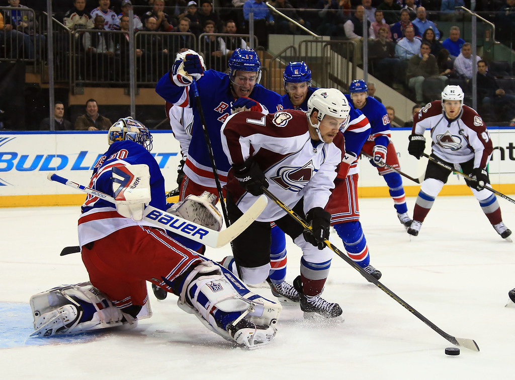 . NEW YORK, NY - NOVEMBER 13: John Mitchell #7 of the Colorado Avalanche attempts to get the shot off against Henrik Lundqvist #30 of the New York Rangers during the first period at Madison Square Garden on November 13, 2014 in New York City.  (Photo by Bruce Bennett/Getty Images)