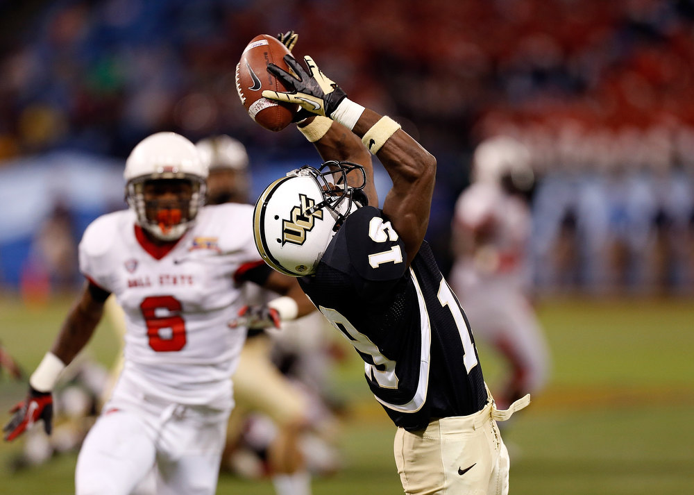 Description of . Receiver Josh Reese #19 of the Central Florida Knights cannot come up with this pass against the Ball State Cardinals during the Beef 'O' Brady's St Petersburg Bowl Game at Tropicana Field on December 21, 2012 in St Petersburg, Florida.  (Photo by J. Meric/Getty Images)