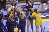 MORGANTOWN, WV - MARCH 8: WVU gymnast Brooklyn Doggette is congratulated by a coach and teammates following her balance beam routine during a dual meet March 8, 2015 in Morgantown, WV.