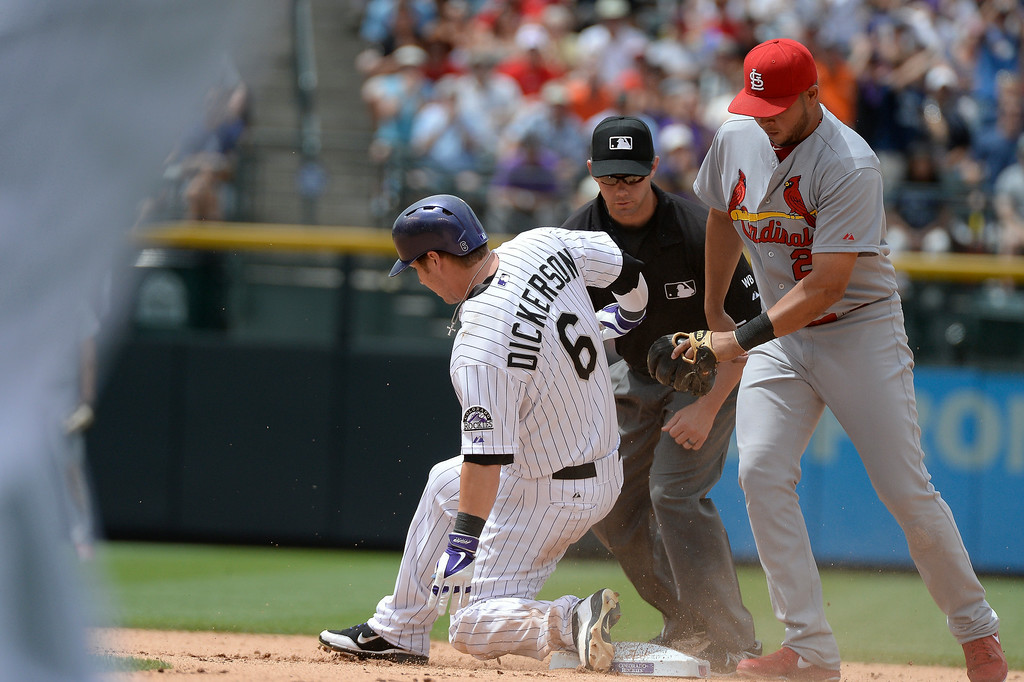 . Colorado Rockies left fielder Corey Dickerson (6) slides in to second base for a double and two run rbi as St. Louis Cardinals shortstop Jhonny Peralta (27) is late with the tag during the fourth inning June 25, 2014 at Coors Field. (Photo by John Leyba/The Denver Post)