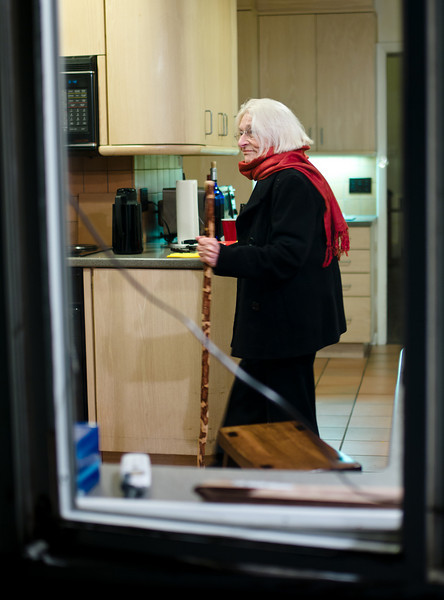 Carol in the kitchen with her Matriarch's staff of office.