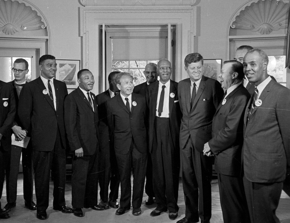 . In this Aug. 28, 1963 file photo, President Kennedy stands with a group of leaders of the March on Washington at the White House in Washington. Immediately after the march, they discussed civil rights legislation that was finally inching through Congress. The leaders pressed Kennedy to strengthen the legislation; the president listed many obstacles. Some believe Kennedy preferred to wait until after the 1964 election to push the issue. Yet in his public speeches, he spoke more and more about justice for all. From second left are Whitney Young, National Urban League; Dr. Martin Luther King, Christian Leadership Conference; John Lewis, Student Non-violent Coordinating Committee, partially obscured; Rabbi Joachim Prinz, American Jewish Congress; Dr. Eugene P. Donnaly, National Council of Churches; A. Philip Randolph, AFL-CIO vice president; Kennedy; Walter Reuther, United Auto Workers; Vice President Lyndon B. Johnson, partially obscured, and Roy Wilkins, NAACP. (AP Photo)