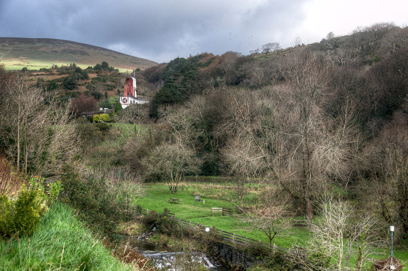 View of the The Great Laxely Wheel amidst canopy - Isle of Man