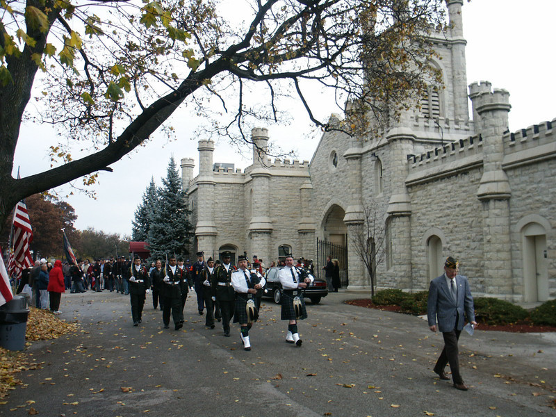 Veterans Day procession marching in front of Rosehill's historic gates