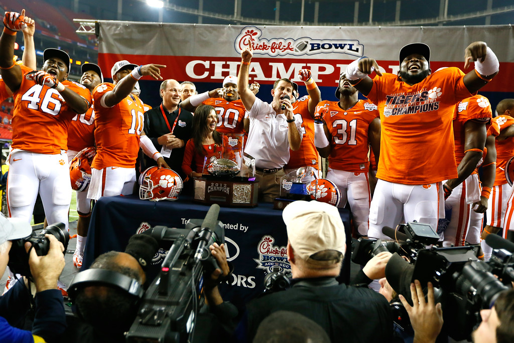 . ATLANTA, GA - JANUARY 01:  Head coach Dabo Swinney and his Clemson Tigers celebrate their 25-24 win over the LSU Tigers during the 2012 Chick-fil-A Bowl at Georgia Dome on December 31, 2012 in Atlanta, Georgia.  (Photo by Kevin C. Cox/Getty Images)
