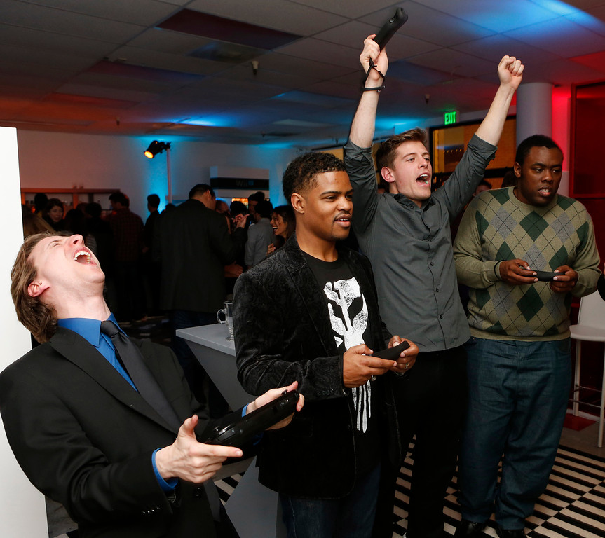 . Jared Knabenbauer (from Pro Jared), Damon Scott (from Broken Pixels), TJ Smith (from Ivy League Punk) and Andre Meadows (from Black Nerd Comedy) play the Wii U at the Nintendo Wii U Video Challenge at the Nintendo Lounge at Sundance 2013, on Thursday, Jan.,17, 2013 in Park City, Utah. (Photo by Todd Williamson/Invision for Nintendo/AP Images)