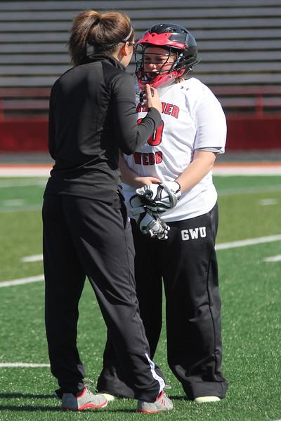 Coach and Reagan Hall talk between plays.