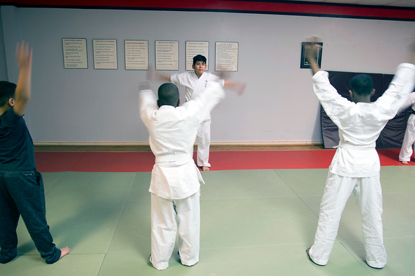 01/07/20 Wesley Bunnell | StaffrrStudents warming up New Britain Judo & Dynamic Arts on West Main St in New Britain.