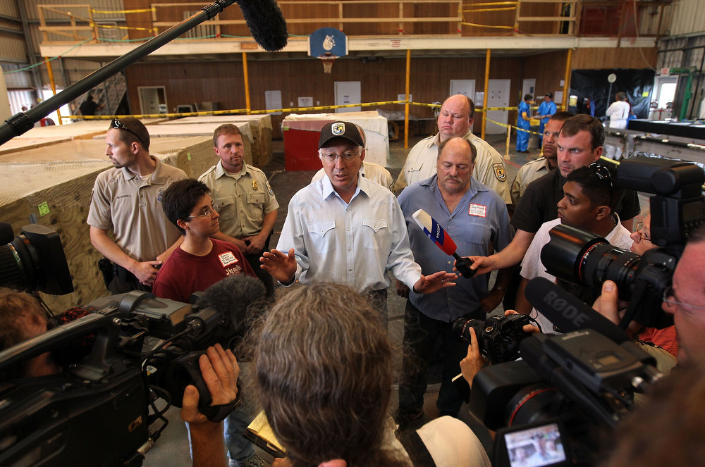 Description of . U.S. Secretary of the Interior Ken Salazar speaks to the media during a visit to the Fort Jackson Wildlife Rehabilitation Center on May 15, 2010 in Buras, Louisiana. Oil continues leaking out of the Deepwater Horizon wellhead as BP continues to work on containing the spill in the Gulf of Mexico off the Louisiana coast.  (Photo by John Moore/Getty Images)