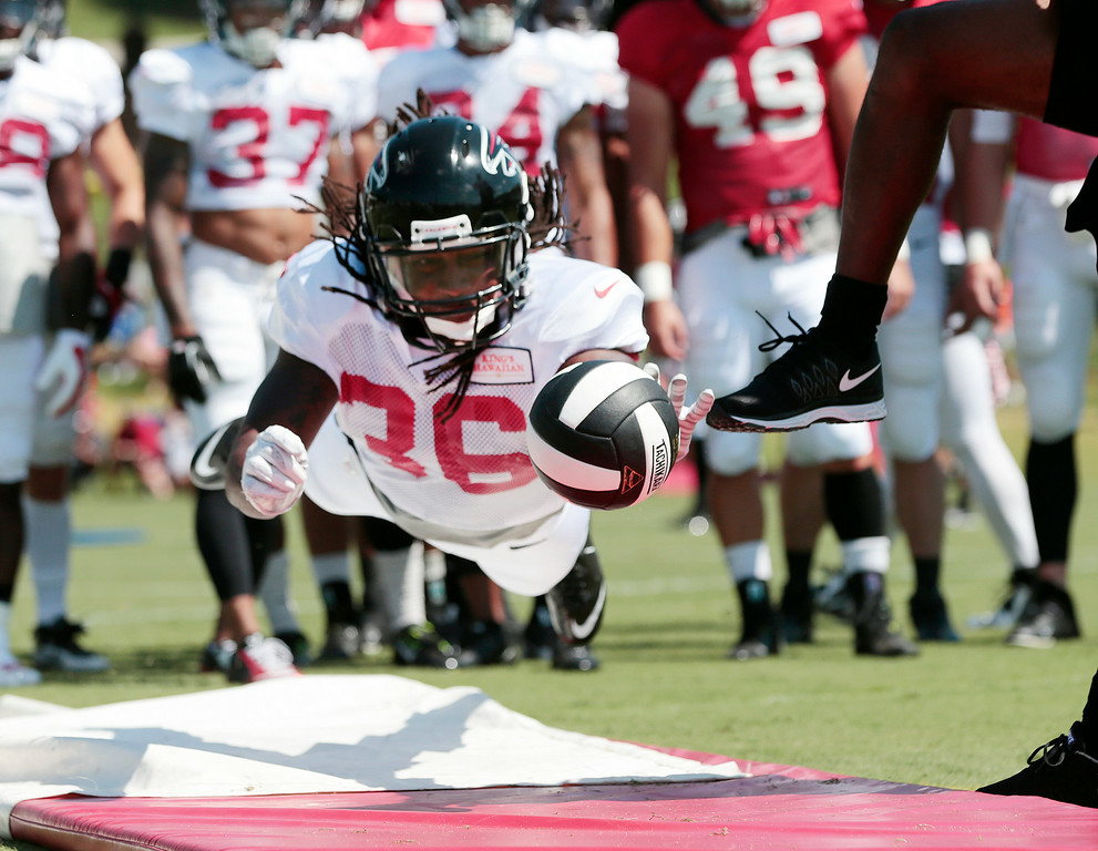 . Atlanta Falcons defensive back Kemal Ishmael (36) works on his punt blocking skills during an NFL football training camp Monday, July 28,  2014, in Flowery Branch, Ga. (AP Photo/John Bazemore)
