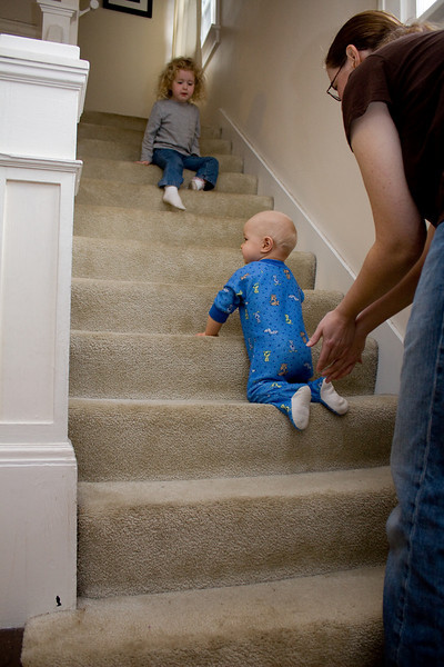 Beverly and Mommy encourage Quinton up the stairs for the first time