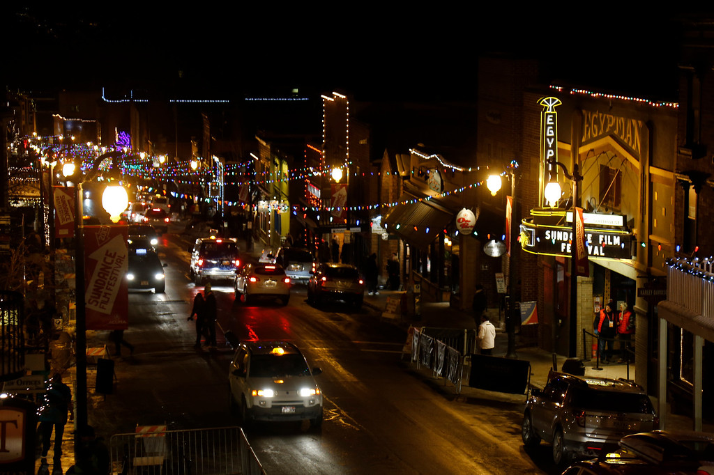 . Cars drive past the marquee at the Egyptian Theatre on Main Street at night during the 2013 Sundance Film Festival on Thursday, Jan. 17, 2013 in Park City, Utah. (Photo by Danny Moloshok/Invision/AP)