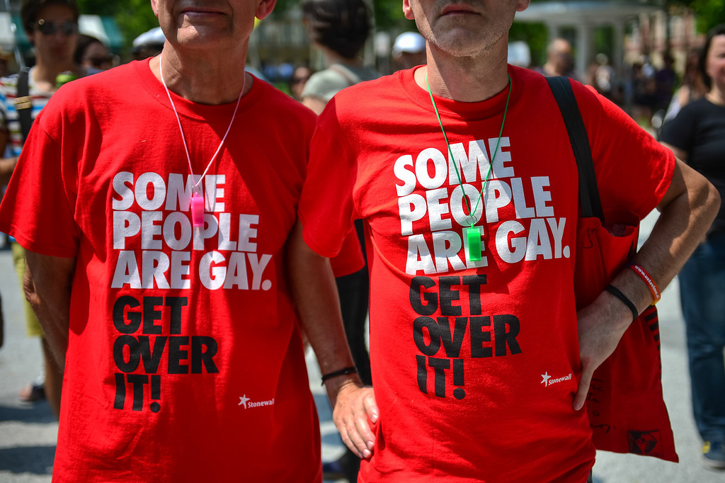 """. Two men wear tee shirts reading \""""Some people are gay. Get over it!\"""" during the Gay Pride Parade in Ljubljana, Slovenia, on June 15, 2013. AFP PHOTO / JURE  Makovec/AFP/Getty Images"""