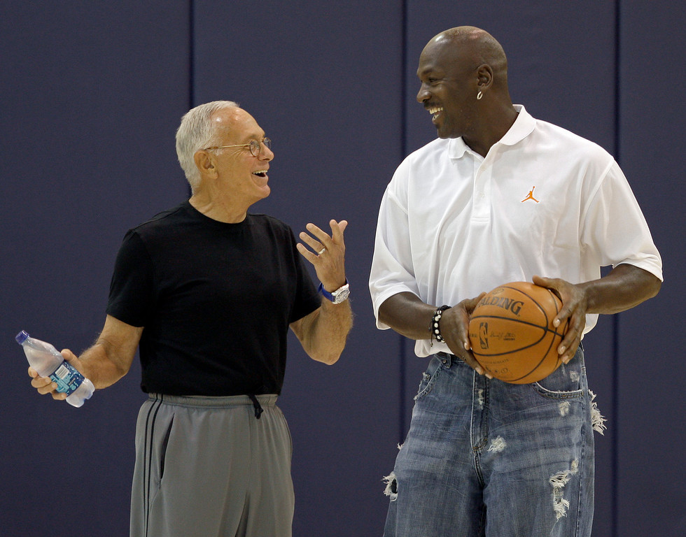 . Charlotte Bobcats coach Larry Brown, left, talks with part-owner Michael Jordan, right, after pre-draft workouts for the team in Charlotte, N.C., Wednesday, June 25, 2008. (AP Photo/Chuck Burton)
