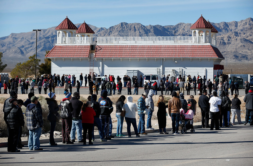 . Patrons line up to buy Powerball lottery tickets outside the Primm Valley Casino Resorts Lotto Store just inside the California border Tuesday, Jan. 12, 2016, near Primm, Nev. The Powerball jackpot has grown to over 1 billion dollars for the next drawing on Wednesday. (AP Photo/John Locher)