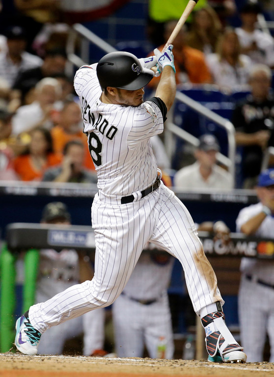 . National League\'s Colorado Rockies third baseman Nolan Arenado (28) singles during the fourth inning, during the MLB baseball All-Star Game, Tuesday, July 11, 2017, in Miami. (AP Photo/Lynne Sladky)