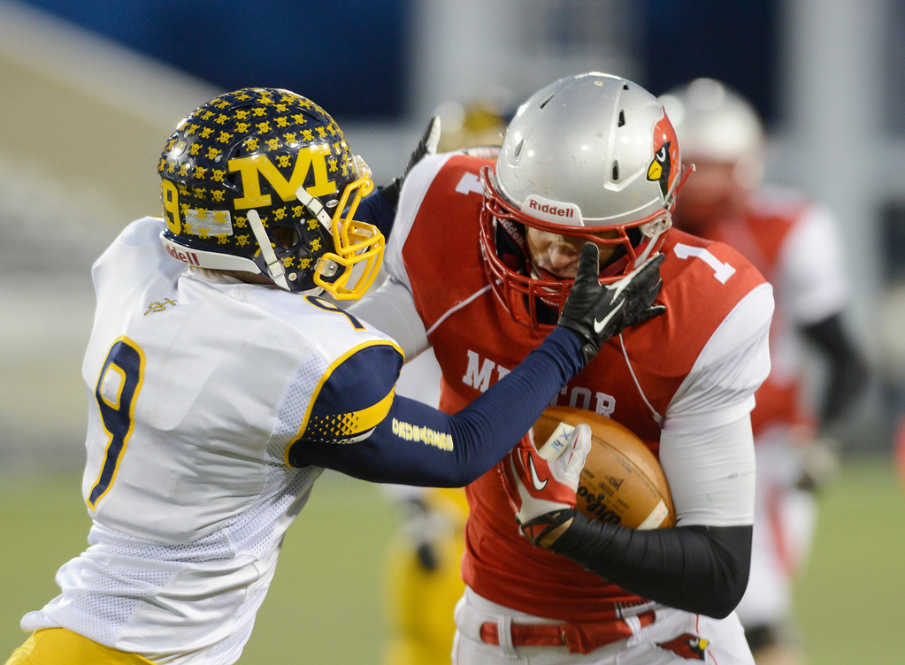 . Maribeth Joeright/MJoeright@News-Herald.com <p> Mentor\'s Brandon Fritts is tackled by Archbishop Moeller Ian Chennell during the third quarter of the Division I state final game against Archbiship Moeller, Saturday, in Canton.