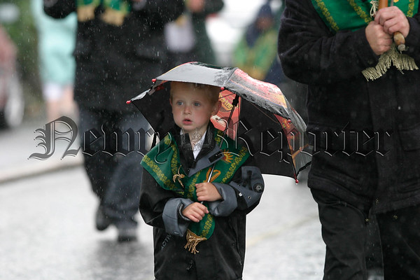 A young forester marches in the rain 07W32N303