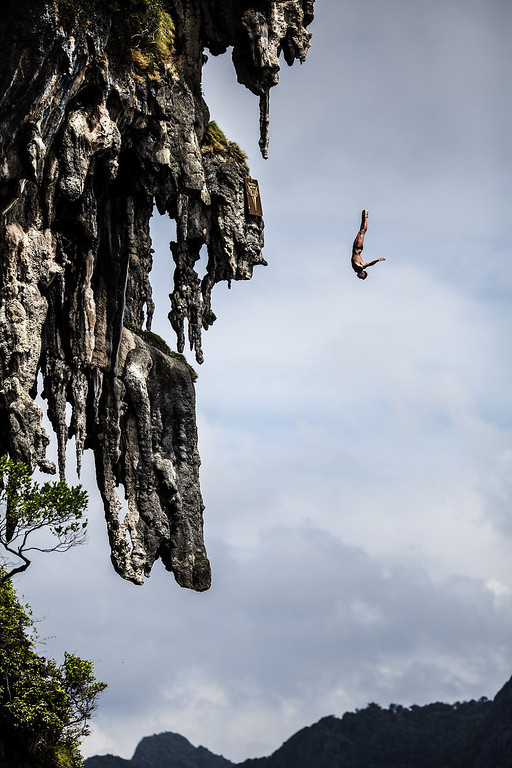 . In this handout image provided by Red Bull, Artem Silchenko of Russia dives from a 25 meter rock at Viking Caves in the Andaman Sea during competition on the fifth day of the final stop of the 2013 Red Bull Cliff Diving World Series on October 24, 2013 at Phi Phi Island, Thailand. (Photo by Dean Treml/Red Bull via Getty Images)