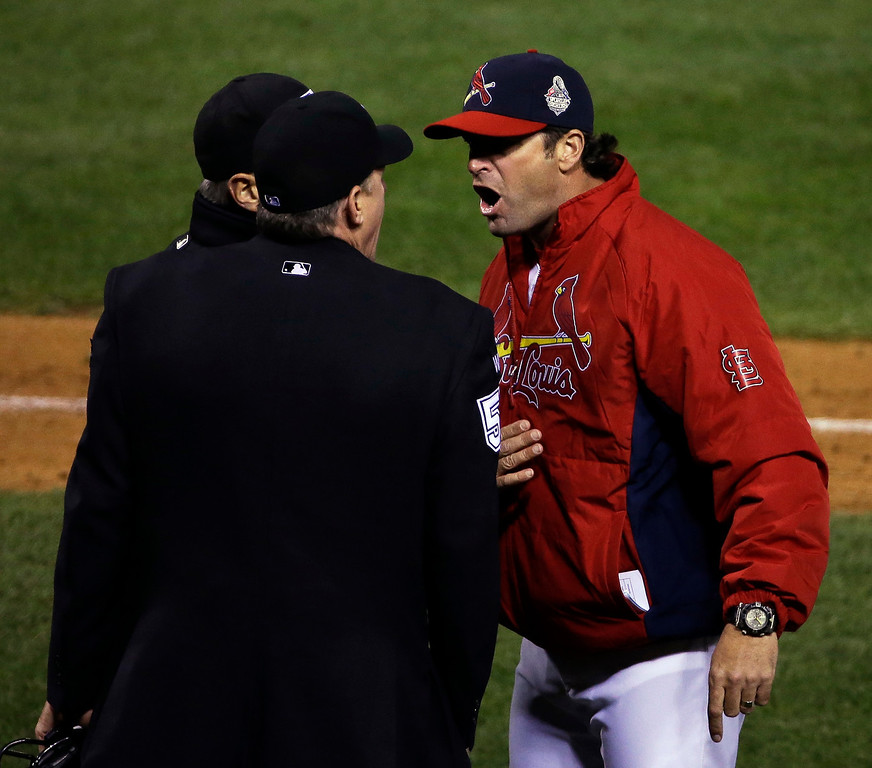 . St. Louis Cardinals manager Mike Matheny argues a call during the fifth inning of Game 4 of baseball\'s World Series against the Boston Red Sox Sunday, Oct. 27, 2013, in St. Louis. (AP Photo/David J. Phillip)