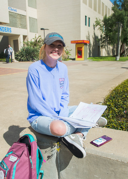 Kassidy Dziuk enjoys the weather while studying for her midterm exams at the Anchor Plaza.
