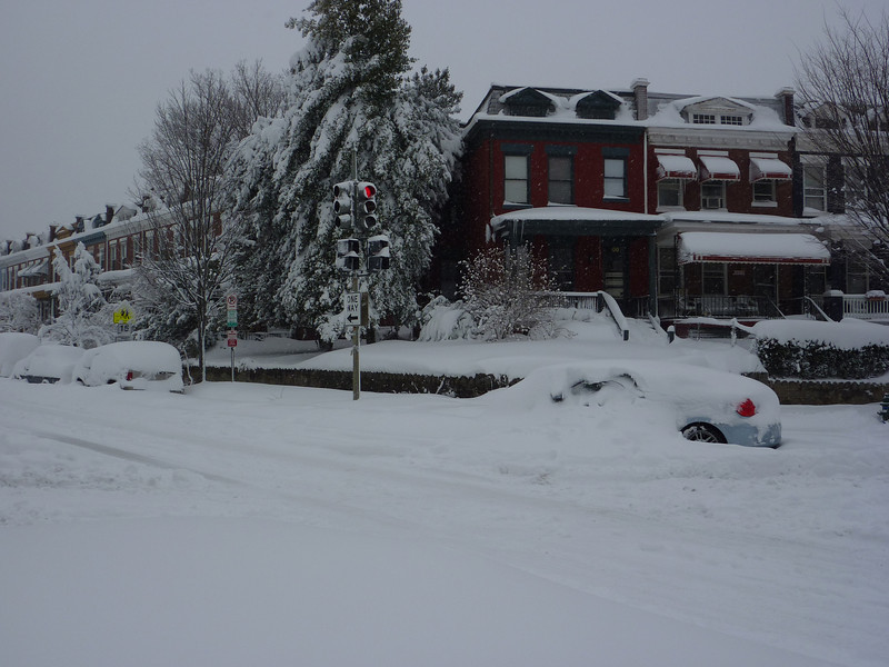 A Prius - Snowed Over in the Intersection