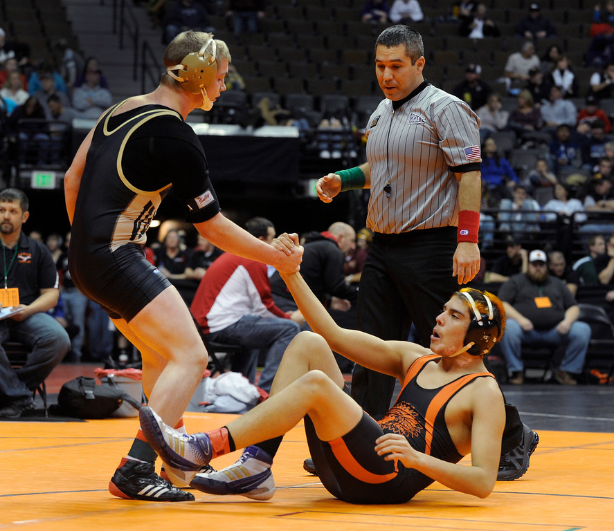 . DENVER, CO. - FEBRUARY 21: Valley High School senior Patrick Gore helped Lamar sophomore Kenny Soto from the mat after Gore pinned Soto in a 160-pound bout in class 3A. The CHSAA State Wrestling Tournament kicked off Thursday, February 21, 2013 at the Pepsi Center in Denver.   (Photo By Karl Gehring/The Denver Post)