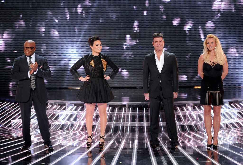""". HOLLYWOOD, CA - NOVEMBER 28: (L-R) Judges L.A. Reid, Demi Lovato, Simon Cowell and Britney Spears onstage at FOX\'s \""""The X Factor\"""" Season 2 Top 8 Live Performance Show on November 28, 2012 in Hollywood, California. (Photo by Frank Micelotta/PictureGroup) via AP IMAGES"""