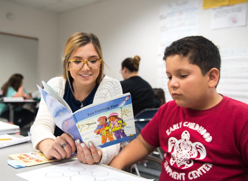 "Kristen Chapa (left) reads Red Rocket Readers ""Ice Fishing Fun"" to Isaac Caudillo"