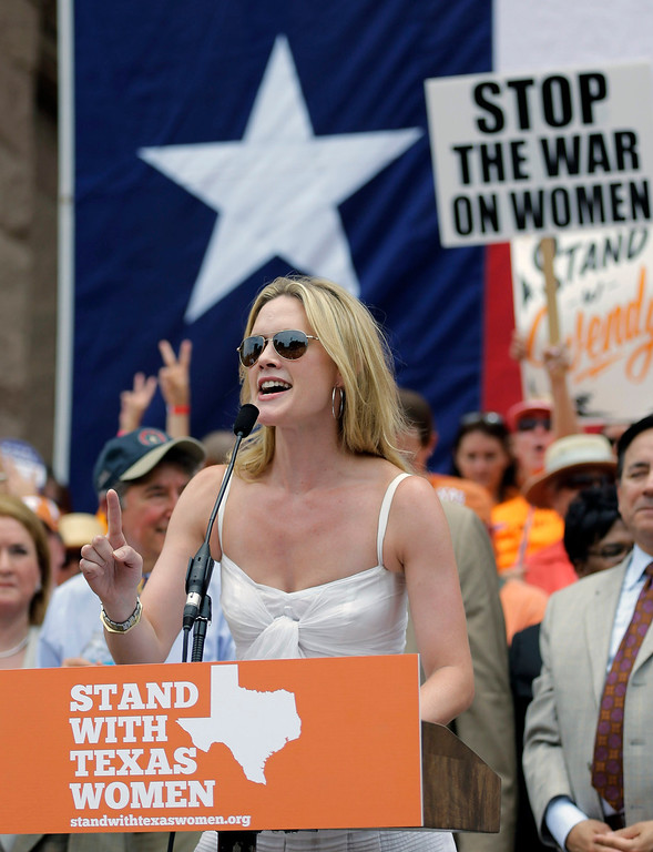. Actress Alexandra Cabot speaks during a rally supporting abortion rights outside the Texas Capitol, Monday, July 1, 2013, in Austin, Texas. The Texas Senate has convened for a new 30-day special session to take up a contentious abortion restrictions bill and other issues. (AP Photo/Eric Gay)