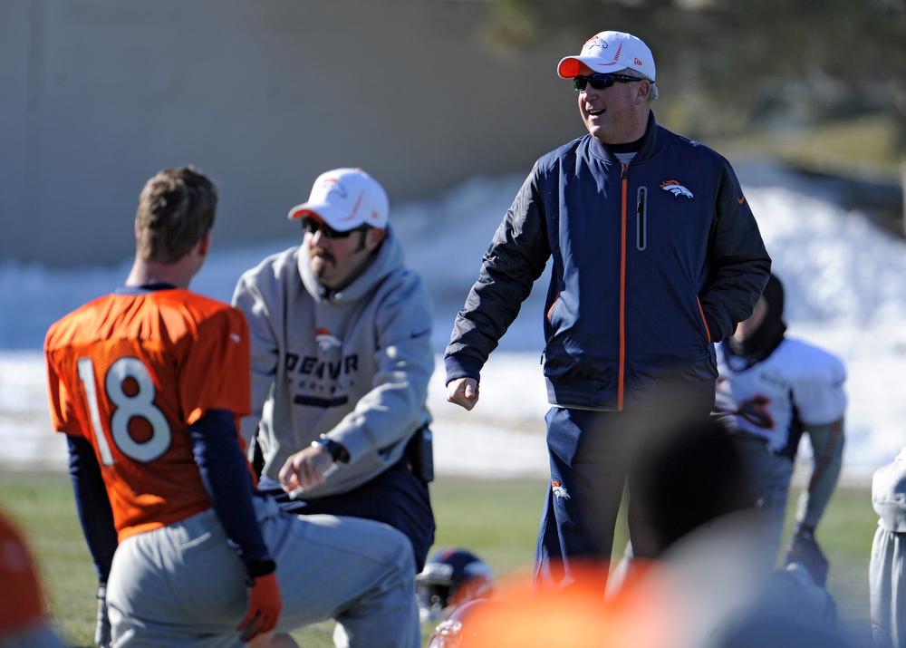 . Denver Broncos head coach John Fox talks with Peyton Manning during practice Thursday, December 20, 2012 at Dove Valley.  John Leyba, The Denver Post