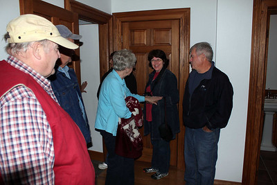 Friends cross paths in the basement of the Anderson ranch home.