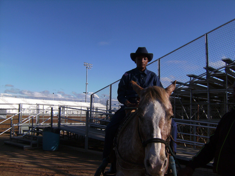 "RAWHIDE ""Bill Pickett Rodeo"" Wild Horse Passes, Chandler.  Young Buffalo Soldier taken a break before the second show of the Grand Entry."