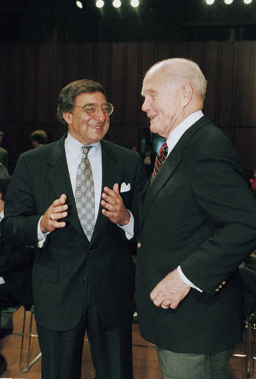 . Budget Director Leon Panetta, left, gestures while talking to Sen. John Glenn (D-Ohio), prior to testifying on Capitol Hill before the Senate Governmental Affairs Committee which was holding hearings on government reform, Feb. 3, 1994.  Before the hearing, Panetta said the business roundtable decision to endorse a rival health care reform plan does not represent a significant setback for President Clinton.  (AP Photo/John Duricka)