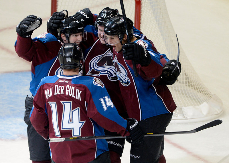 . DENVER, CO. - FEBRUARY 2ND: Colorado Avalanche teammates, David Van Der Gulik, #14, bottom, Matt Duchene, left, Jamie McGinn, center, and Erik Johnson celebrate McGinn\'s go ahead goal in the second period against the Edmonton Oilers at the Pepsi Center in Denver Colorado, February 2nd, 2013. The Avalanche went on to win 3-1.  (Photo By Andy Cross / The Denver Post)
