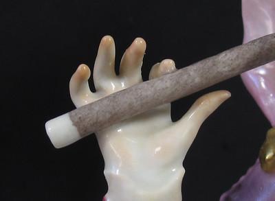 Meissen porcelain figure (flute player)