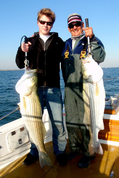 11/8/2009  I fished today with my girlfriend Lenie and her son Russell.  We went out for a few hours in the afternoon and had a blast.  We found some good bait and drifted live bait and tossed plugs for some real nice striped bass. These two fish were 27 and 31 pounds.  Russell angled both fish and had a great time of it. Lenie acted as photographer and supplied encouragement to Russ.  It was a fun afternoon. I think the fishing is going to be excellent for the next two weeks. The big fish are inside the inlet and the bait is just starting to move.  An excellent afternoon on the water.  Captain Al Lorenzetti