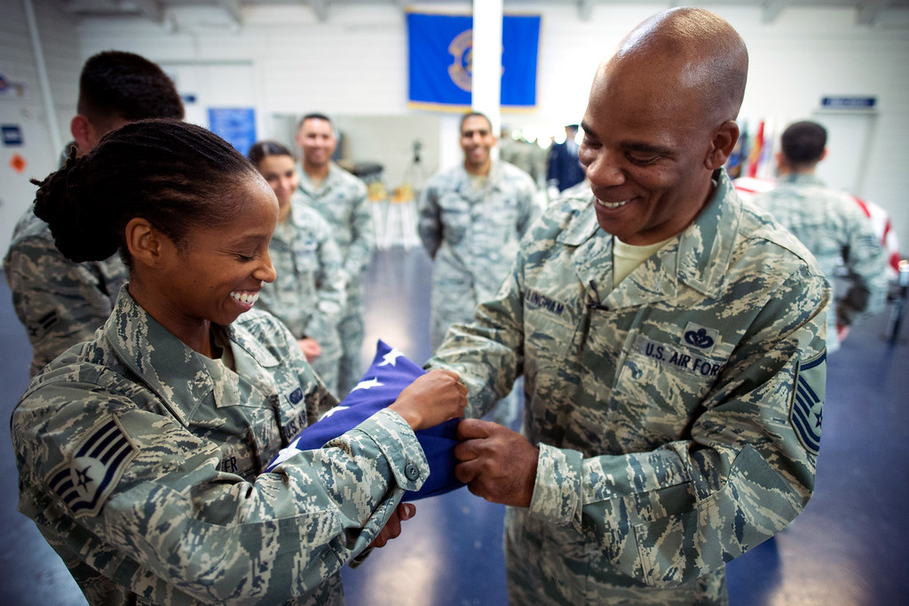 . Master Sgt. Darryl Willingham, right, with Staff Sgt. Zakia Webster demonstrate flag folding to the Blue Eagles Honor Guard trainees at March Air Reserve Base in Riverside, Calif. on Wednesday, May 13, 2015. (Photo by Watchara Phomicinda/ Los Angeles Daily News)