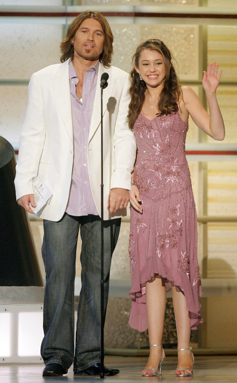. Billy Ray Cyrus and his daughter, actress Miley Cyrus, present an award during the 41st Academy of Country Music Awards, Tuesday, May 23, 2006, in Las Vegas. (AP Photo/Mark J. Terrill)