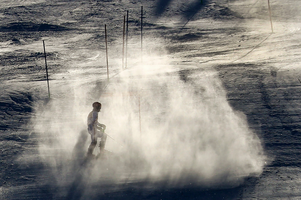 . Marcel Hirscher, of Austria, stands in a cloud of snow after missing a gate during the first run of the men\'s slalom at the 2018 Winter Olympics in Pyeongchang, South Korea, Thursday, Feb. 22, 2018. (AP Photo/Morry Gash)