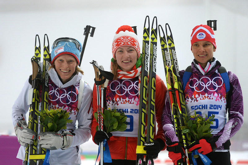 . (L-R) Silver medalist Tora Berger of Norway, gold medalist Darya Domracheva of Belarus and bronze medalist Teja Gregorin of Slovenia stand on the podium during the flower ceremony for the the Women\'s 10 km Pursuit during day four of the Sochi 2014 Winter Olympics at Laura Cross-country Ski & Biathlon Center on February 11, 2014 in Sochi, Russia.  (Photo by Harry How/Getty Images)