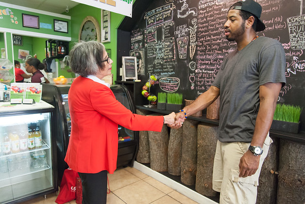 08/02/18 Wesley Bunnell | Staff Ruby Corby O'Neill shakes hands after speaking with Juann McClendon at Sweetwater Juice Bar & Deli on Thursday afternoon during a stop on her tour of downtown New Britain. O'Neill is running for for Congress for Connecticut's 5th district.
