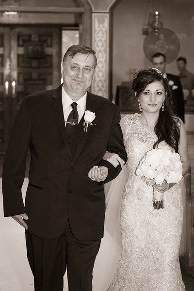 Father takes the bride down the isle at St. Nectarios Greek Orthodox Church in Palatine, IL, outside of Chicago.